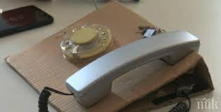 Абитуриенти изобретиха телефон с шайба и СИМ карта